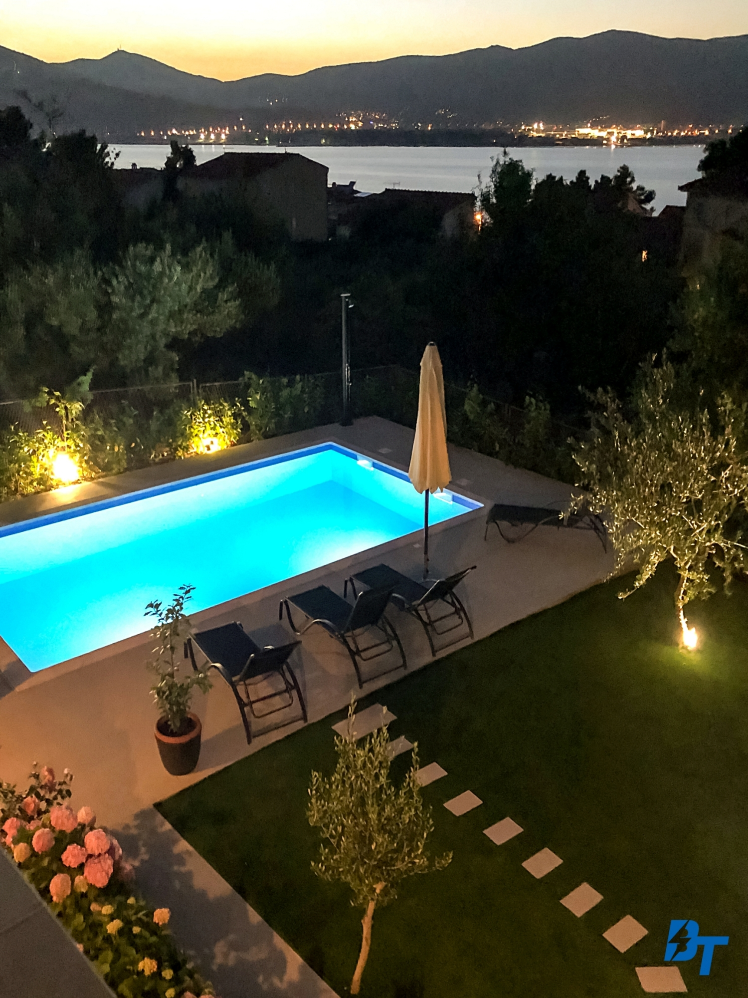 Enjoy Watching the View of the Pool and Sea in the Evening